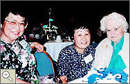 Photo of three women sitting at a table