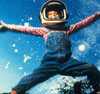Young girl wearing space helmet jumping in the air